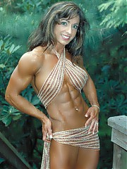 The beautiful Karen Zaremba hits the bodybuilding shots. She combines the best of all worlds, very good figure muscle combined with glamorous girl-next-door looks, and a very friendly camera presence.