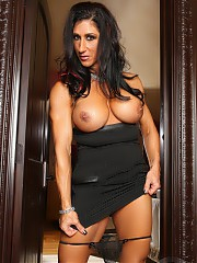 Sexy Elisa Ann strips off her sexy black dress and shows off her big, strong body.