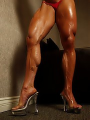 Bodybuilder Angela Salvano peels off SheMuscle her tank top and panties and gets nude in the bedroom. She's big and ripped and vascular all over, and you won't want to miss a single pose. Her perfect pecs, lovely legs, tight calves, bulging biceps and awesome abs will make you want to stay in that bedroom for a while.