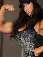 Big strong bodybuilder Angela Salvagno strips and flexes every inch of her ripped up body.