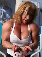 Big strong bodybuiler Wanda Moore works out, flexes and strips.