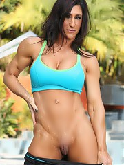 Fit and muscular Elisa Ann strips off her gym clothes outside.